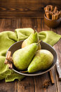 Pears fresh green on a plate Stock Images