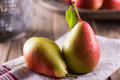 Pears fresh juicy on wooden table Stock Photography