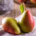 Pears fresh juicy on wooden table Stock Image