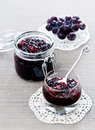 Pears grape jam in glass jar Stock Photography