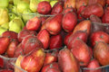 Pears at a market stall vinous and green Royalty Free Stock Image