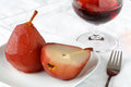 Pears poached in red wine in a white bowl Royalty Free Stock Photo