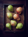 Pears on a rustic tray Royalty Free Stock Photos