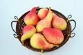 Pears in a winnowing basket red delicious juicy Royalty Free Stock Photos