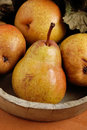 Pears in the wooden bowl pile of Royalty Free Stock Images