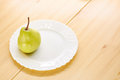 Pears on a wooden table http thumbs dreamstime com x jpgon in white plate Stock Photo