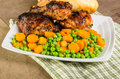 Peas and carrots with chicken served fried Stock Image
