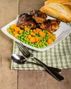 Peas and carrots with chicken served fried Royalty Free Stock Images