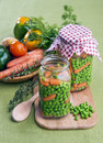 Peas with carrots in glass jar Royalty Free Stock Photography