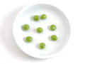 Peas fresh green on a white plate Stock Photo