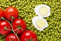 Peas and Tomatoes Royalty Free Stock Images