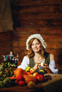 Peasant woman cook a festive meal to the day of harvest retro stylized image Royalty Free Stock Photo