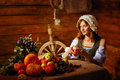 Peasant woman cook a festive meal to the day of harvest retro stylized image Stock Photo