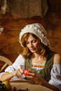Peasant woman cook a festive meal to the day of harvest retro stylized image Royalty Free Stock Image