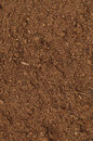 Peat turf macro closeup large detailed brown organic humus soil background pattern vertical Royalty Free Stock Photography
