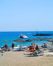 Pebble beach and the sea tourists swim and sunbathe beldibi turkey june Royalty Free Stock Photos