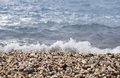 Pebble beach sea wave incident on the coastal shingle Royalty Free Stock Photo