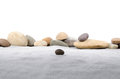 Pebble stones on gray sand Royalty Free Stock Photo
