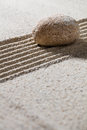 Pebble on straight lines for of meditation or progression zen sand still life textured concept closeup Stock Photography