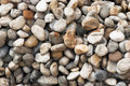 Pebble texture of grey yellow orange and white colors Royalty Free Stock Photos