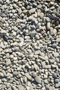 Pebbles background created by various pebble stones Royalty Free Stock Image