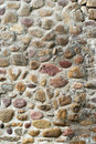 Pebbles built the wall side of large cobblestone Stock Images