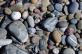 Pebbles close view of colorful sea Royalty Free Stock Images