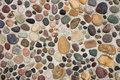 Pebbles in Concrete Royalty Free Stock Photo