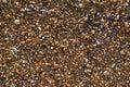 Pebbles mixed with sand of the beautiful Skala beach, Kefalonia island, Ionian sea, Greece Royalty Free Stock Photo