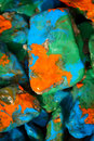 Pebbles painted in different colors bright abstract background stones with paint close Royalty Free Stock Photo