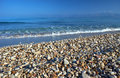 Pebbles on a sandy beach Royalty Free Stock Photo