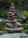 Pebbles stacked stones as a stone statue short depth of field statues on the river vydra bohemian forest forest on background oval Royalty Free Stock Photo