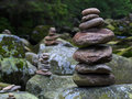 Pebbles stacked stones as a stone statue short depth of field statues on the river vydra bohemian forest forest on background oval Royalty Free Stock Photography