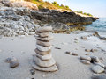 Pebbles tower on a sandy beach Royalty Free Stock Photo