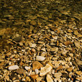 Pebbles under water. Royalty Free Stock Images