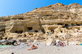 Pebbly beach matala greece crete matala has become famous for artificial neolithic caves carved in limestone rocks during the s Stock Image