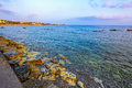 Pebbly beach in paphos cyprus background at sunset from Royalty Free Stock Image