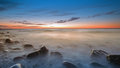 The pebbly beach in rozewie at dusk Royalty Free Stock Photos