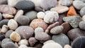 Pebbly seashore background close up shot Royalty Free Stock Photos