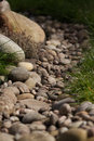 Pebbly stream bed pebbles in the sun Royalty Free Stock Photo