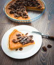 Pecan cake and pumpkin on white plate on wooden background Stock Photo