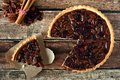 Pecan cranberry pie, overhead rustic table scene with cut slice Royalty Free Stock Photo