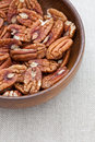Pecan nuts in wooden bowl Stock Image