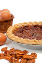 Pecan pie with ingredients on a white background Royalty Free Stock Photography