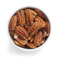 Pecans in Bowl over White Overhead View Royalty Free Stock Images