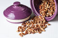 Pecans and canister shelled pecan nuts falling out of plum Stock Photography