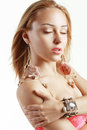 Peculiar woman with shell earrings and wooden bracelet Stock Photos