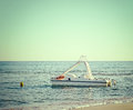 Pedal boat near the beach line vintage effect Stock Image