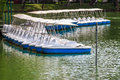 Pedal boats locked at peaceful lake marina recreation equipment Royalty Free Stock Image