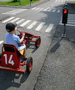 Pedal car in traffic lights Stock Image